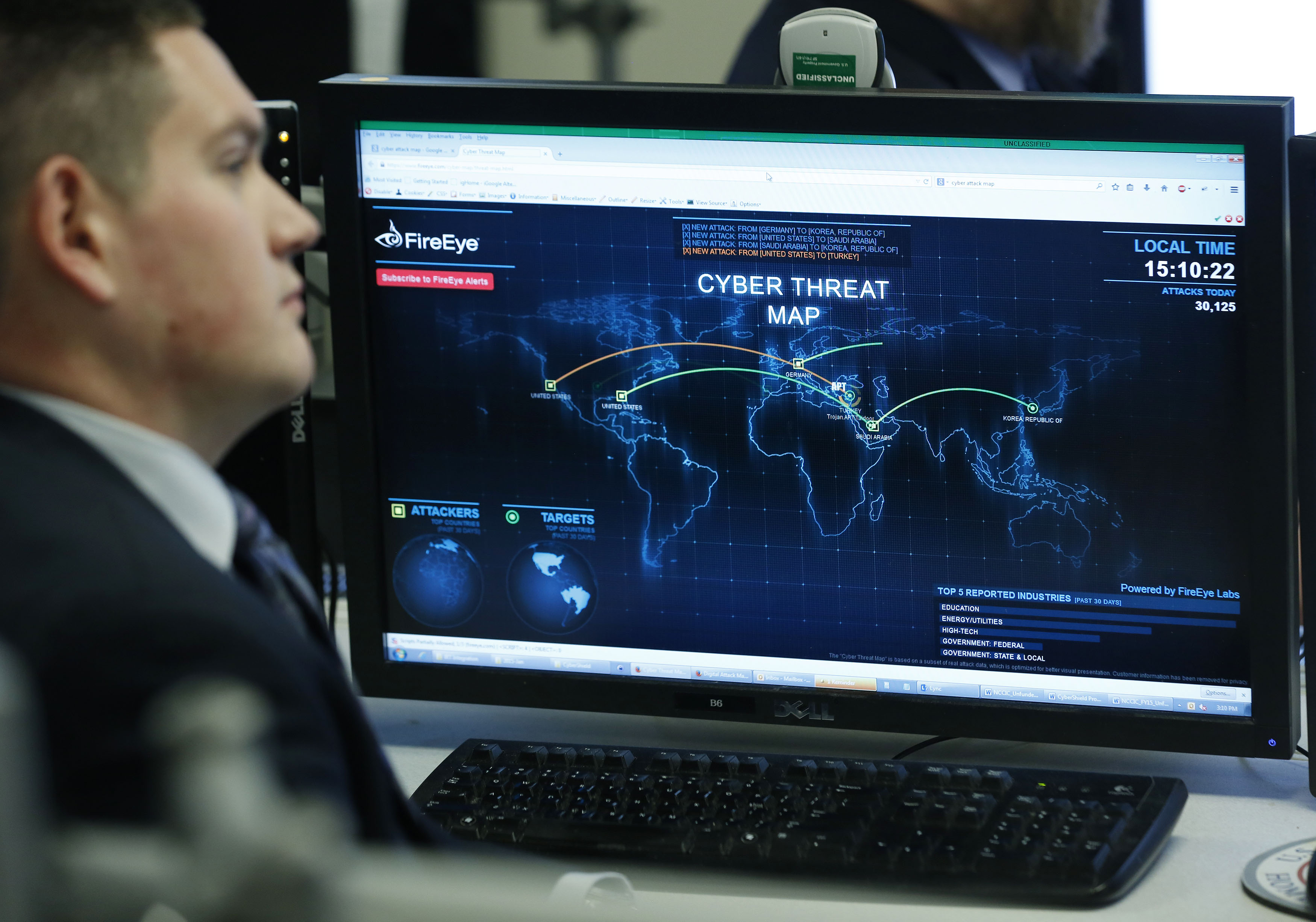 A computer monitor displays a cyber threat map
