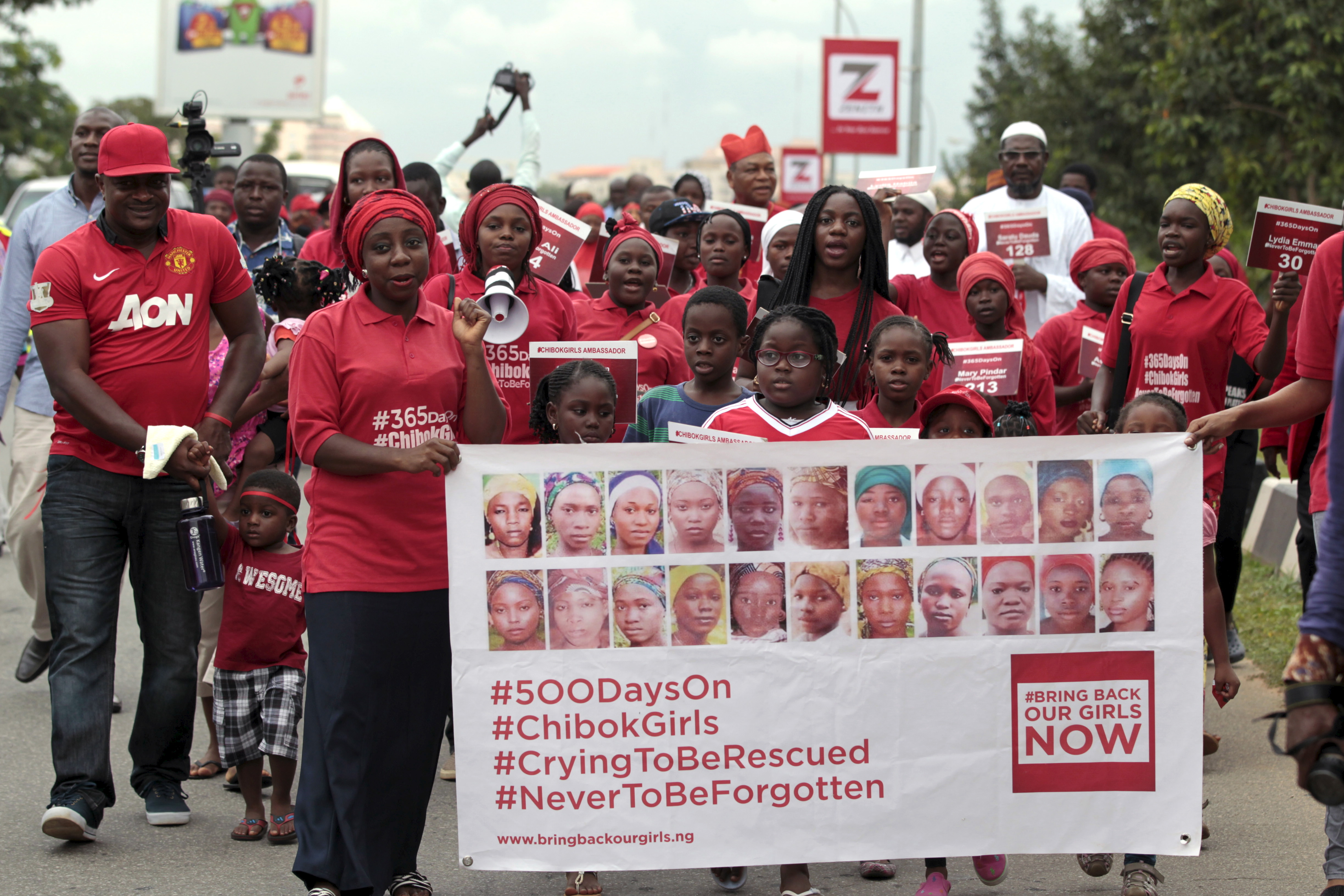 Protesters hold a sign calling for the return of the kidnapped Chibok Girls