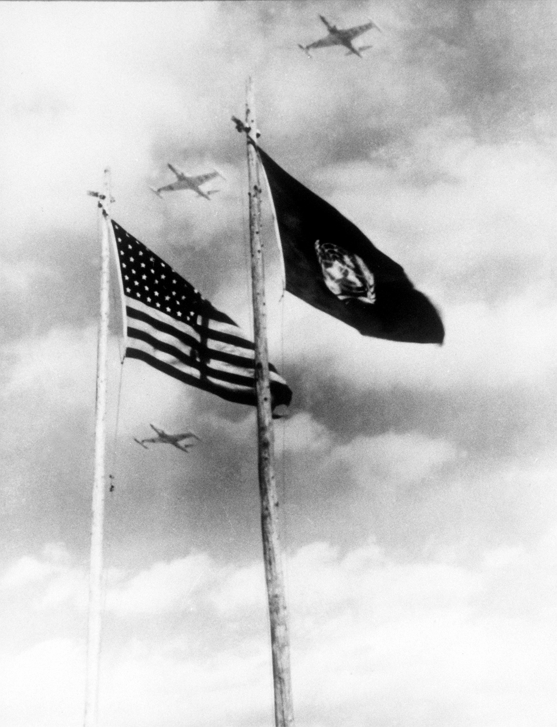 United States and UN flags waving.