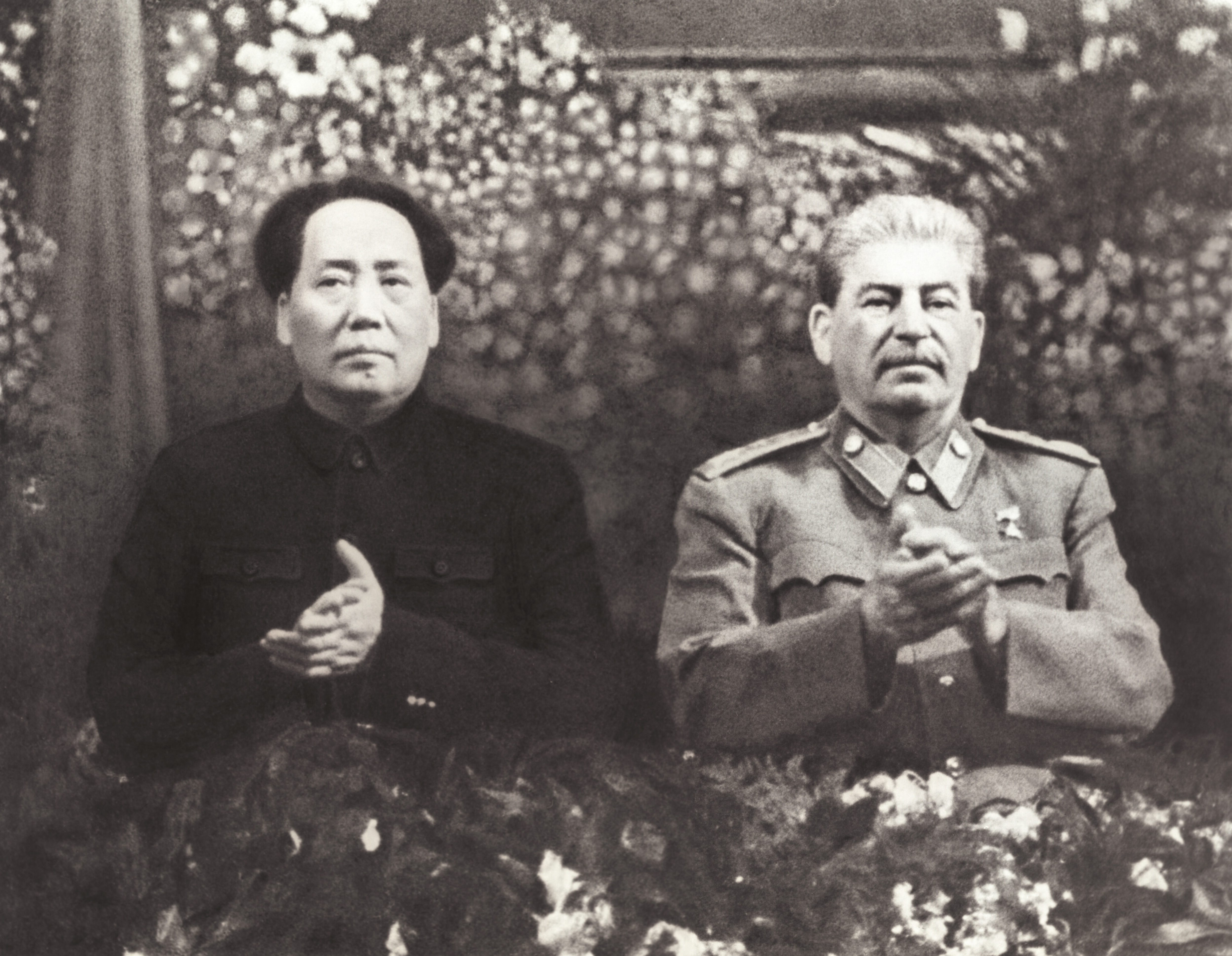 Mao Zedong and Josef Stalin.