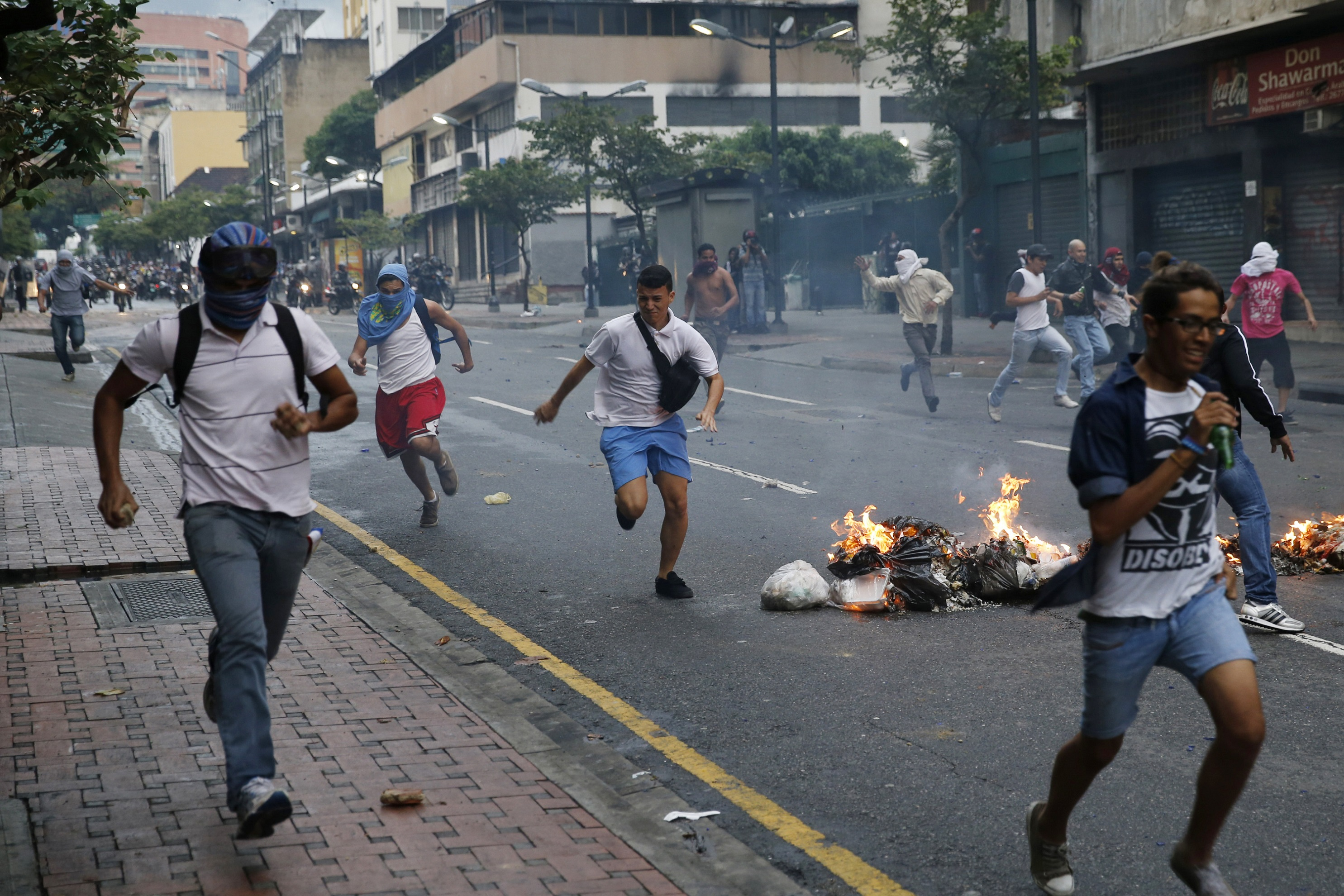 Venezuelans running in the streets.