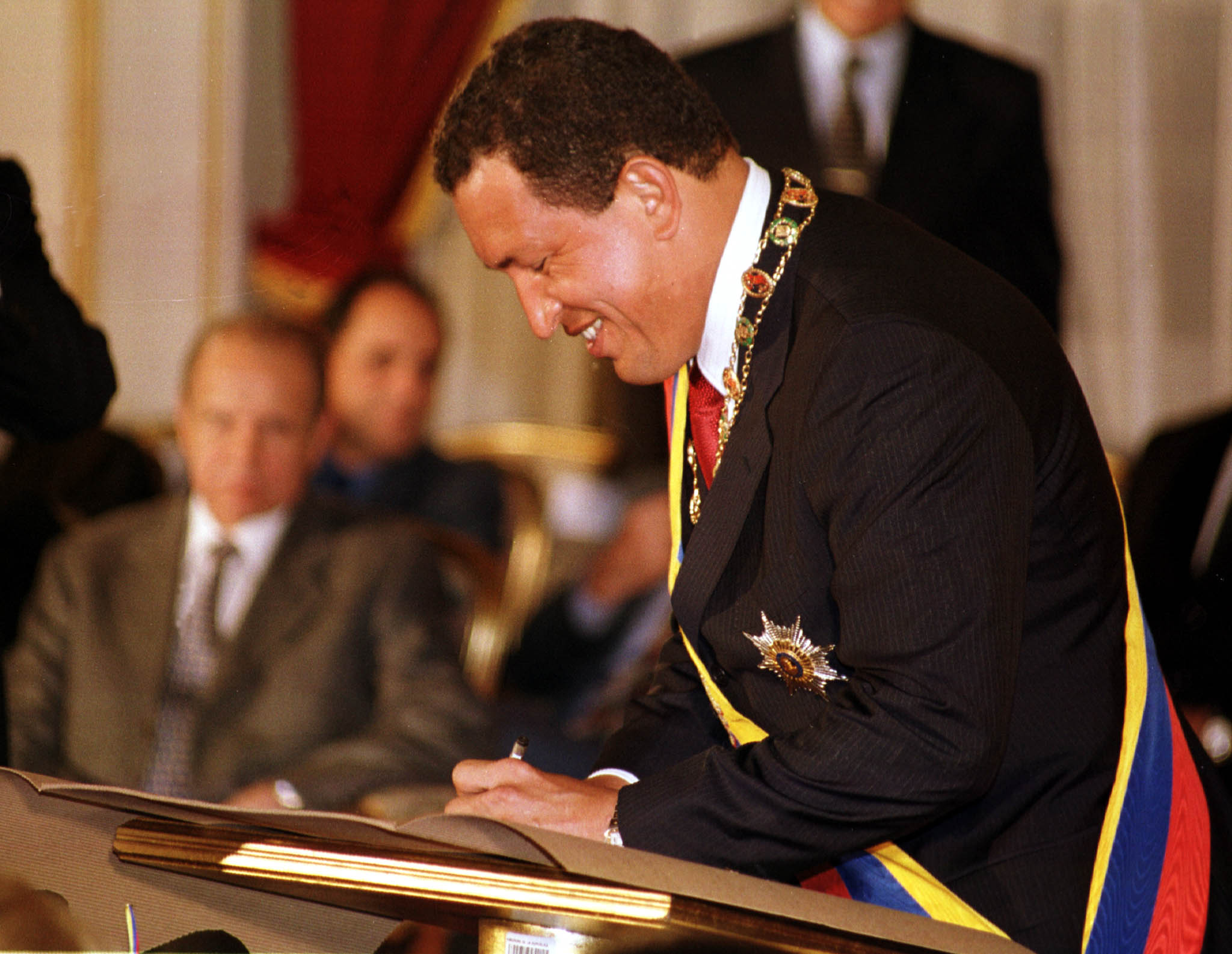 Chavez signing a document.