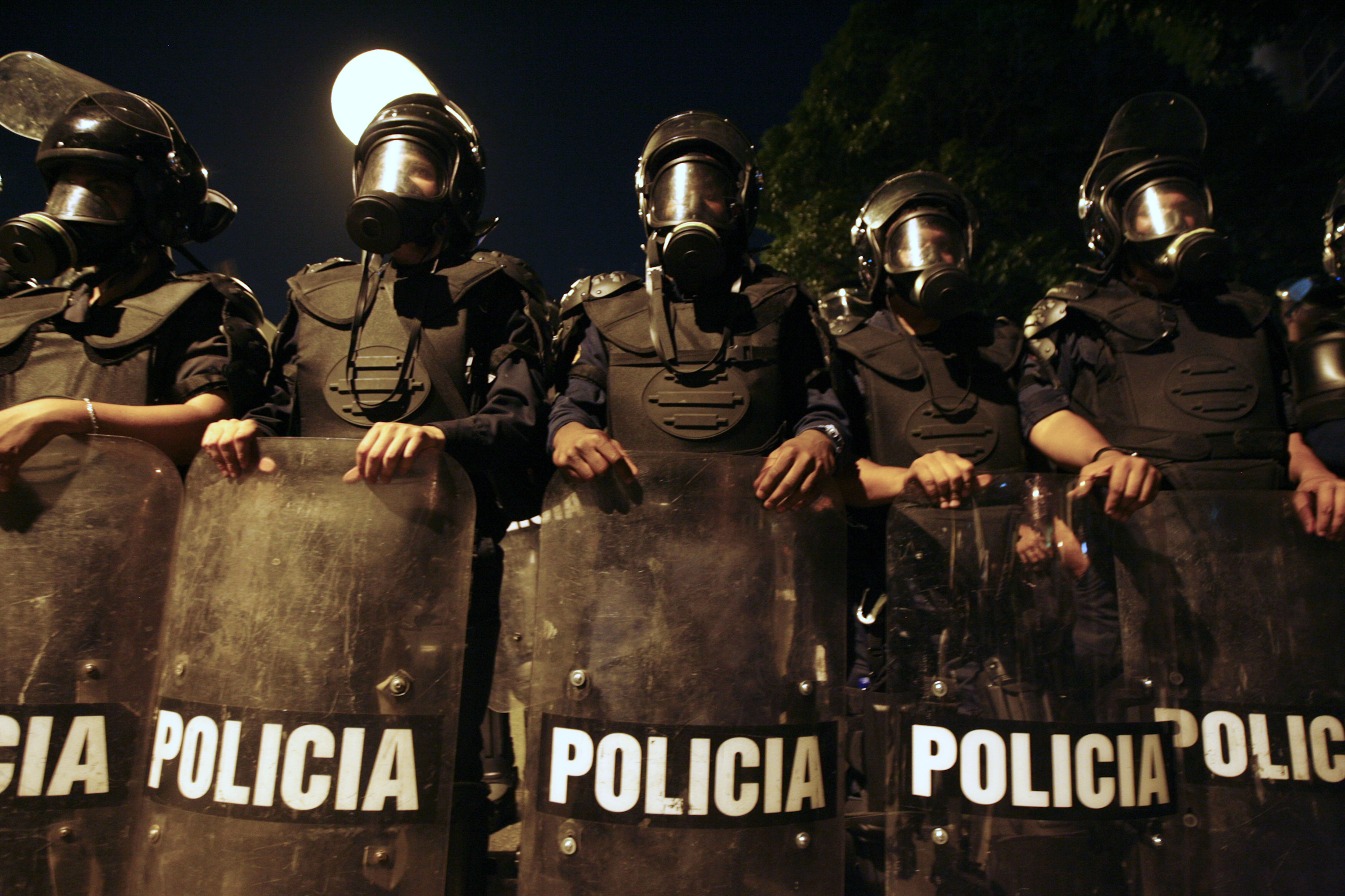 Venezuelan policemen wearing anti-riot gear.