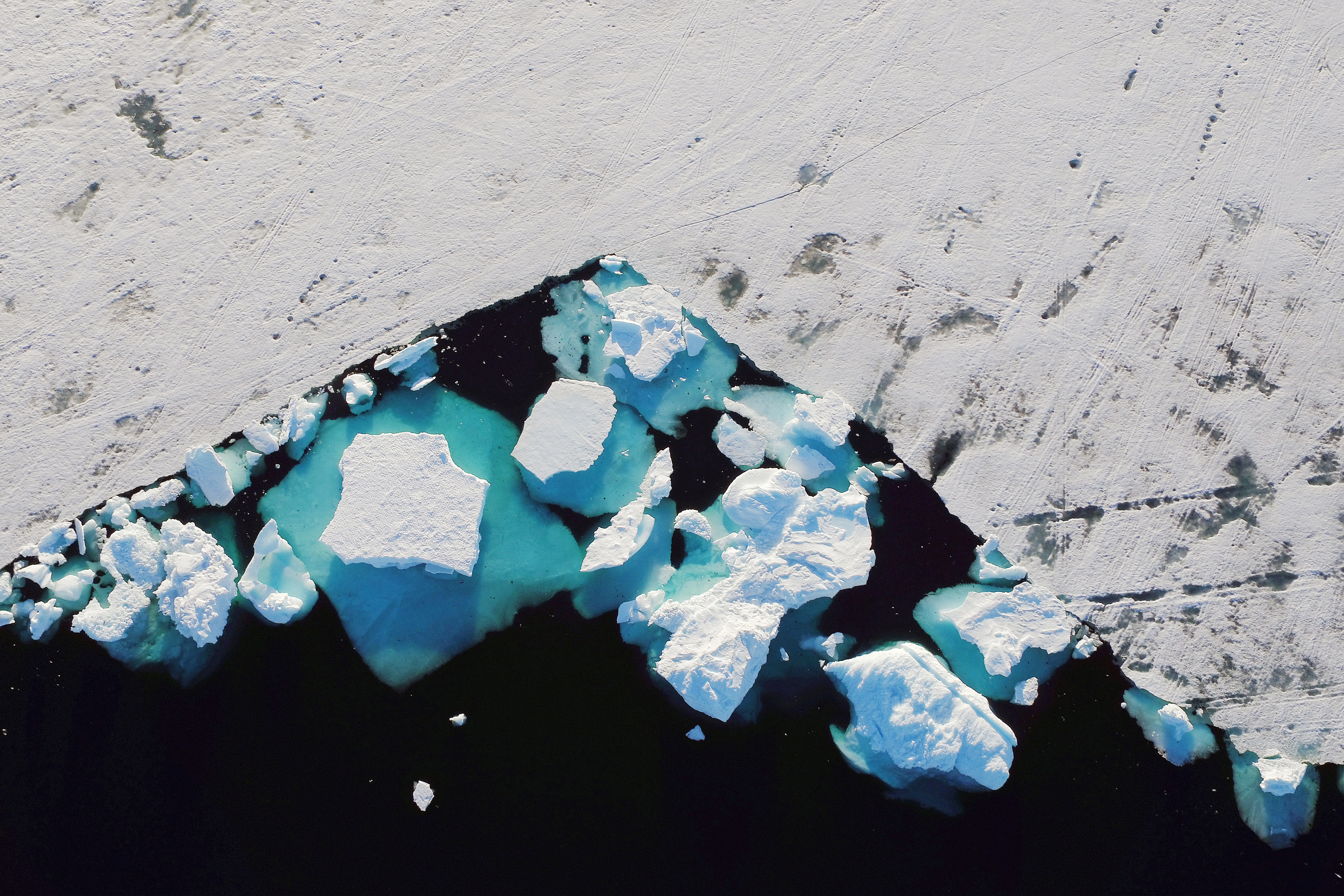 iceberg floating off the coast of Greenland