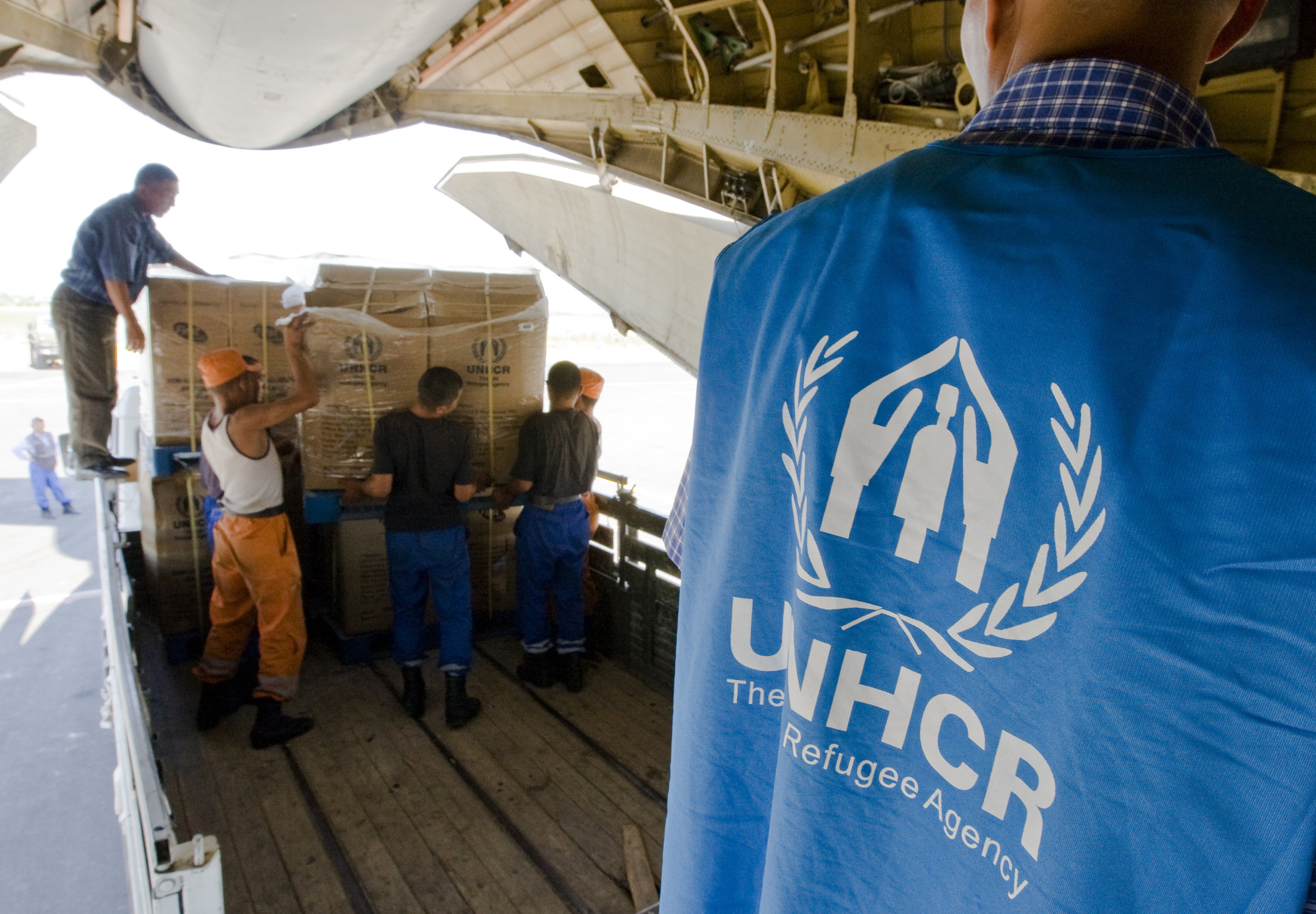 UNHCR representatives distributing aid.