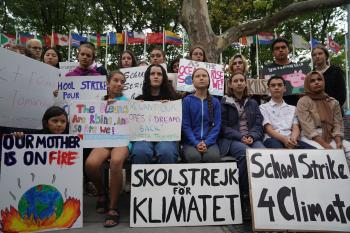 Young activists gather outside the United Nations during a protest against climate change