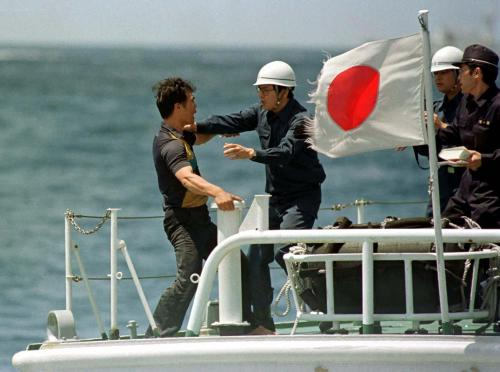 Japanese coast guard clash with a protester