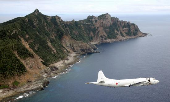 A Japanese aircraft circles a group of disputed islands known as Senkaku in Japan and Diaoyu in China in the East China Sea